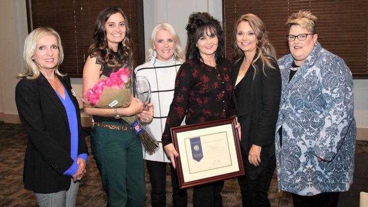 Karen Davidson holding award
