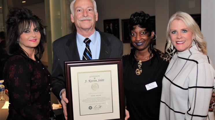 Paul Allan holding award